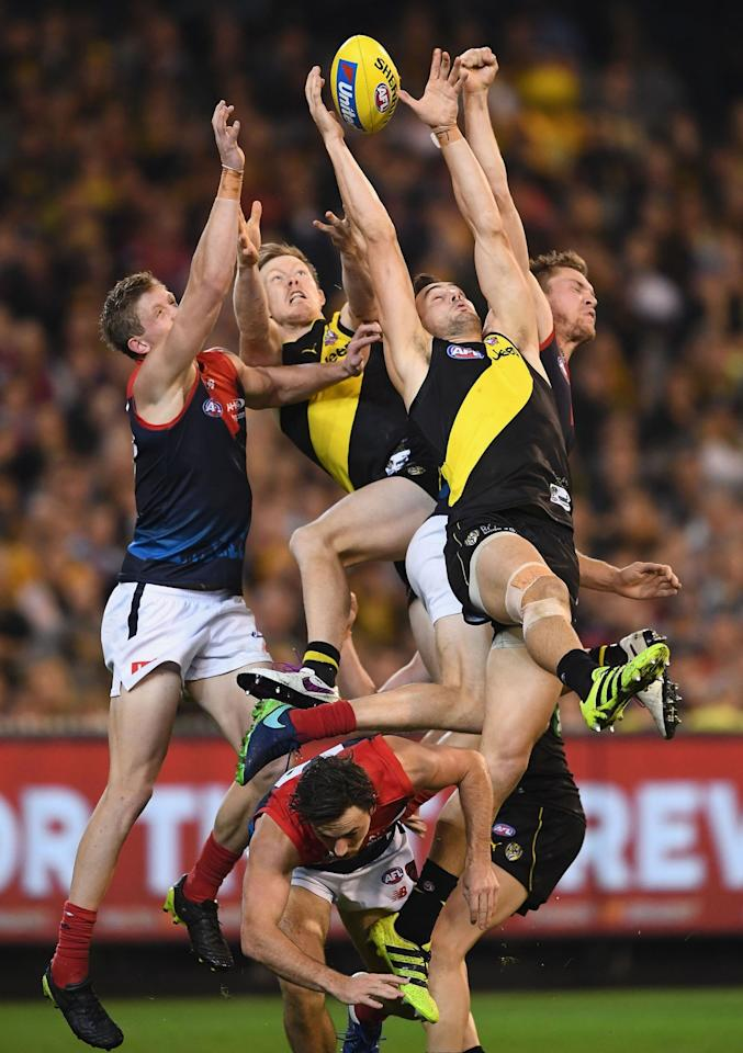 <p>Todd Elton of the Tigers attempts to mark during the round five AFL match between the Richmond Tigers and the Melbourne Demons at Melbourne Cricket Ground on April 24, 2017 in Melbourne, Australia. (Quinn Rooney/Getty Images) </p>