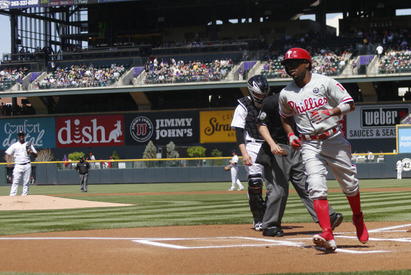 Rollins gets key hits, Phillies beat Rockies 10-9