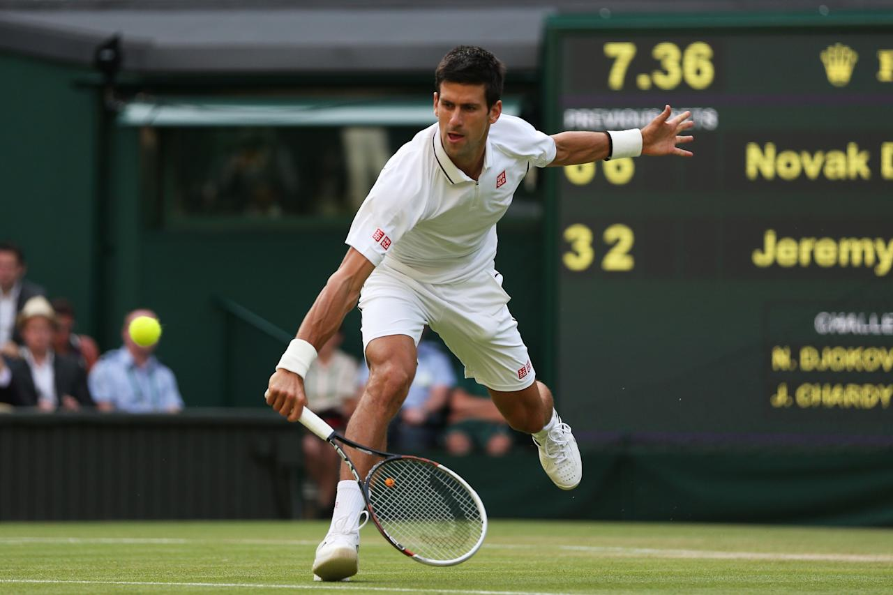 LONDON, ENGLAND - JUNE 29: Novak Djokovic of Serbia plays a backhand during the Gentlemen's Singles third round match against Jeremy Chardy of France on day six of the Wimbledon Lawn Tennis Championships at the All England Lawn Tennis and Croquet Club on June 29, 2013 in London, England. (Photo by Clive Brunskill/Getty Images)