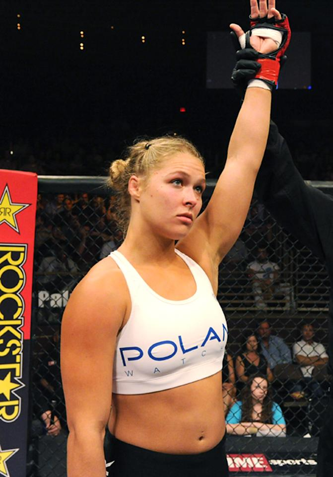 LAS VEGAS - AUGUST 12:  Ronda Rousey celebrates after her victory over Sarah D'Alelio at the Pearl at the Palms on August 12, 2011 in Las Vegas, Nevada.  (Photo by Kari Hubert/Forza LLC/Forza LLC via Getty Images)