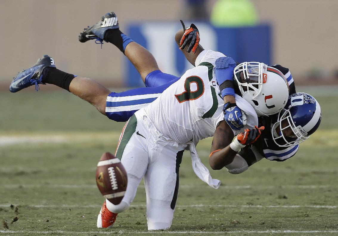 Duke's Jeremy Cash, right, breaks up a pass intended for Miami's Malcolm Lewis (9) during the first half of an NCAA college football game in Durham, N.C., Saturday, Nov. 16, 2013. (AP Photo/Gerry Broome)