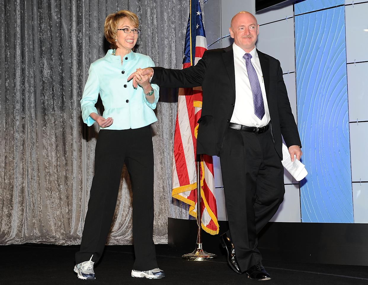 BEVERLY HILLS, CA - MAY 23:  Congresswoman Gabrielle Giffords and husband astronaut Mark Kelly attend the Simon Wiesenthal Center's Annual National Tribute Dinner Honoring Jerry Bruckheimer at The Beverly Hilton Hotel on May 23, 2012 in Beverly Hills, California.  (Photo by Valerie Macon/Getty Images)
