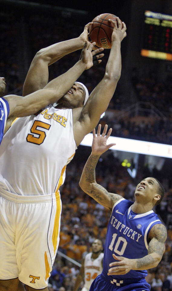 Tennessee's Jarnell Stokes (5) is fouled as he goes for a shot as Kentucky's Twany Beckham (10) looks on during the first half of an NCAA college basketball game on Saturday, Jan. 14, 2012, in Knoxville, Tenn. (AP Photo/Wade Payne)