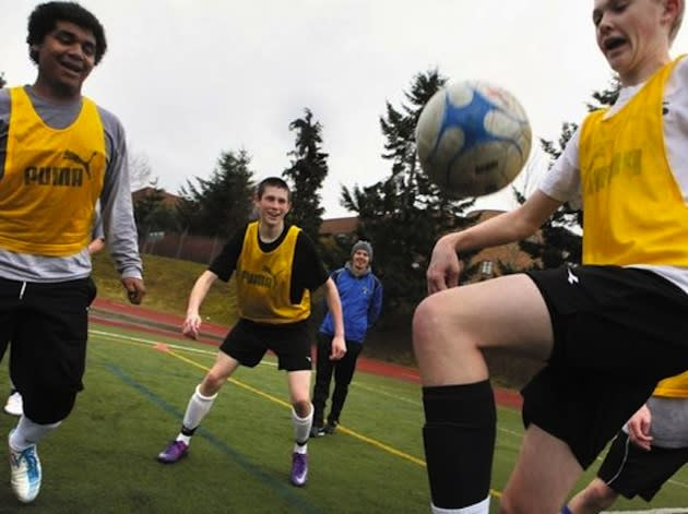 The Curtis High soccer team at practice — Tacoma News-Tribune