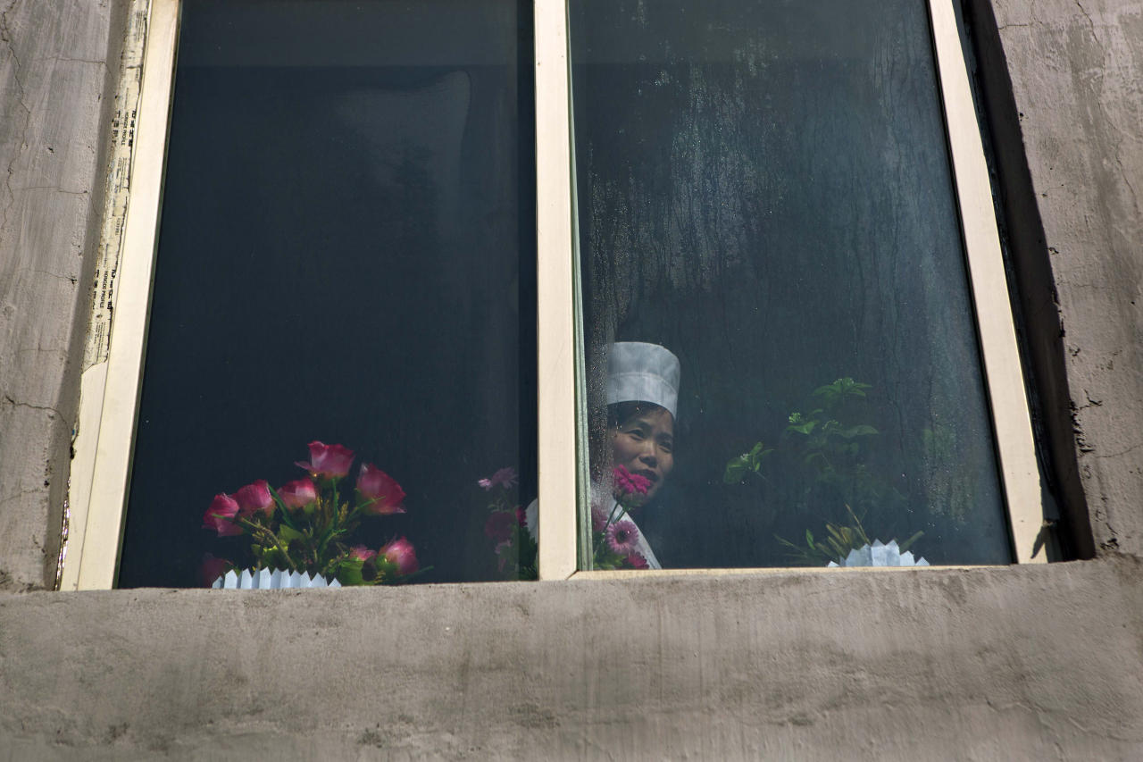 A North Korean nurse looks out of a window at a neighborhood health clinic in Pyongyang, North Korea on Thursday, Feb. 21, 2013. (AP Photo/David Guttenfelder)
