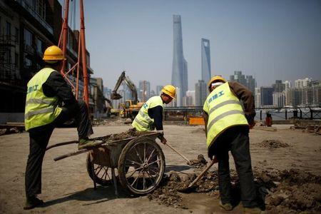 China factories put weight behind forecast-busting 6.9% GDP