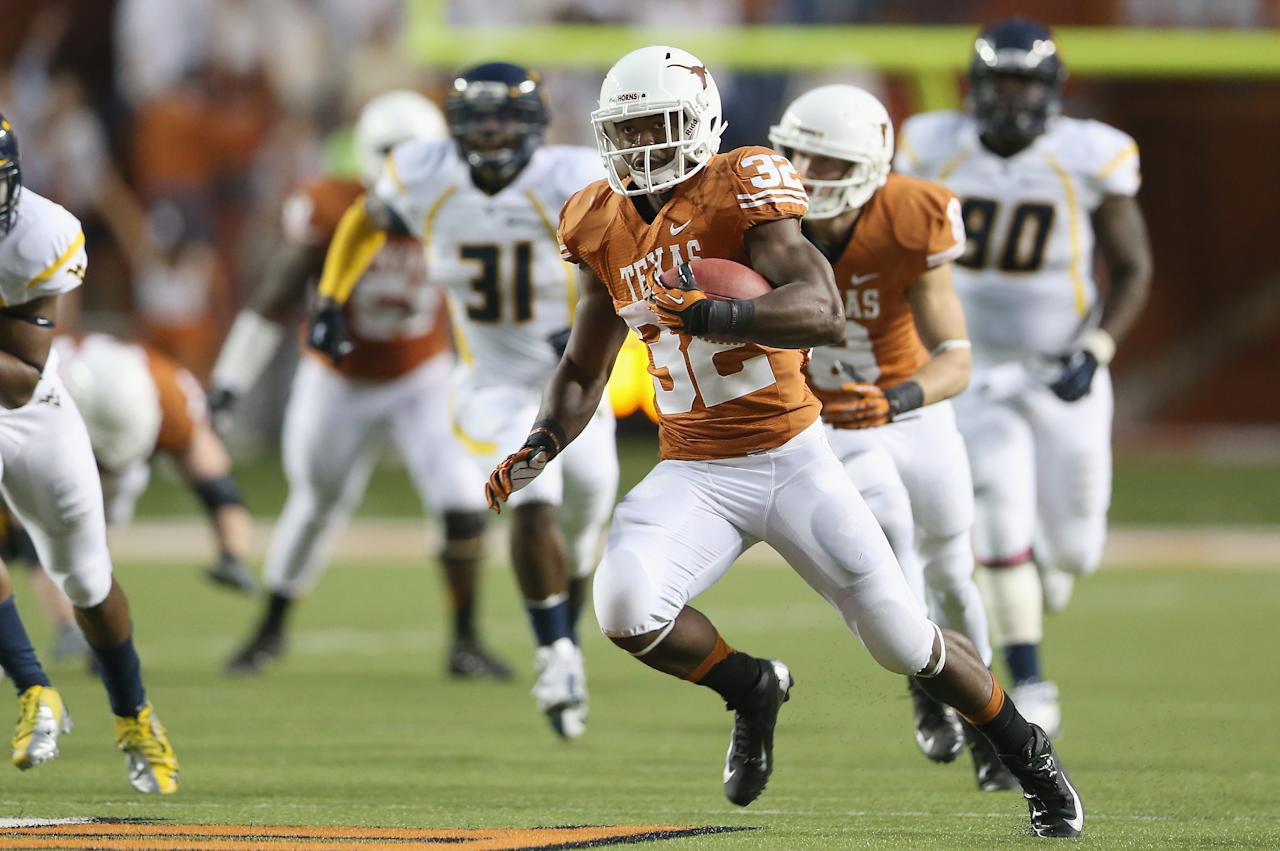 AUSTIN, TX - OCTOBER 06:  Johnathan Gray #32 of the Texas Longhorns runs the ball against the West Virginia Mountaineers at Darrell K Royal-Texas Memorial Stadium on October 6, 2012 in Austin, Texas.  (Photo by Ronald Martinez/Getty Images)