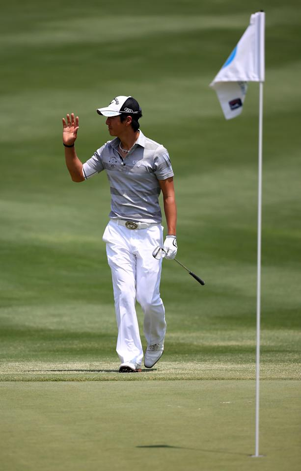 IRVING, TX - MAY 18:  Ryo Ishikawa of Japan reacts after chipping in fo a birdie on the 18th green during the third round of the 2013 HP Byron Nelson Championship at the TPC Four Seasons Resort on May 18, 2013 in Irving, Texas.  (Photo by Tom Pennington/Getty Images)