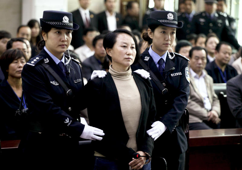 China tries ex-banker with many homes on ID fakery