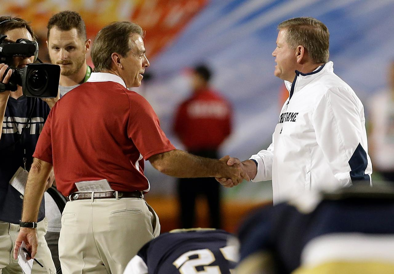 Alabama head coach Nick Saban, left, shakes hands with Notre Dame head coach Brian Kelly before the BCS National Championship college football game Monday, Jan. 7, 2013, in Miami. (AP Photo/Chris O'Meara)