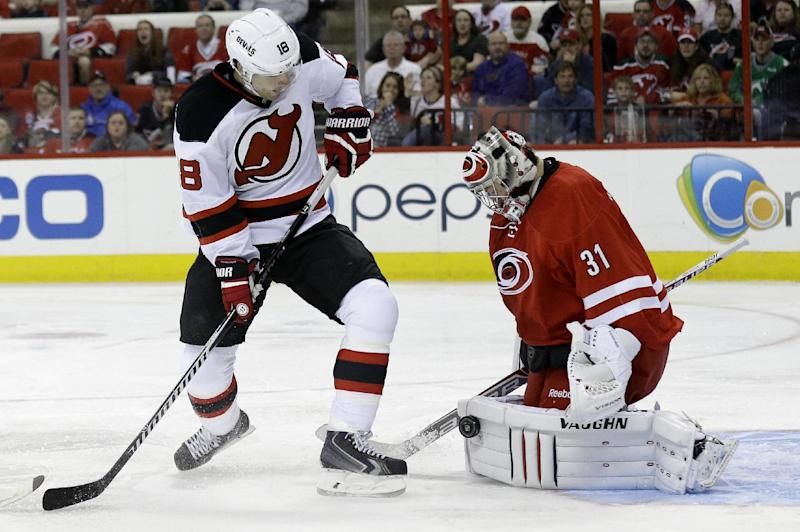 Devils earn points in 7th straight, beat Canes 3-1