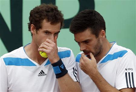 Britain's Murray chats with teammate Fleming during their Davis Cup quarter-final doubles tennis match against Italy in Naples