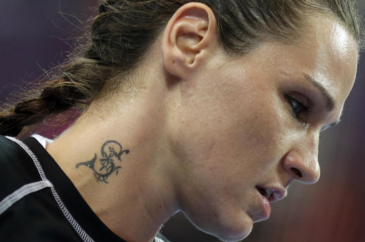 Montenegro's Ana Radovic sports a tattoo during the women's handball preliminary match against Russia at the 2012 Summer Olympics, Sunday, Aug. 5, 2012, in London. (AP Photo/Matthias Schrader)