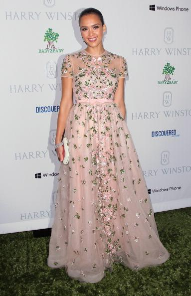"<div class=""caption-credit""> Photo by: Getty Images</div><div class=""caption-title"">A little Valentino</div>This gorgeous, blush Valentino ballgown adorned with silver flowers merited Alba's appearance on InStyle.com's <i>Prettiest Dress of the Year.</i>"