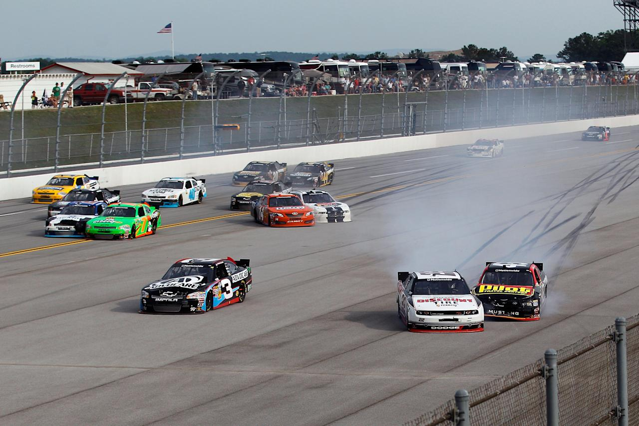 TALLADEGA, AL - MAY 05:  Brad Keselowski, driver of the #22 Discount Tire Dodge, spins towards the inside wall during the NASCAR Nationwide Series Aaron's 312 at Talladega Superspeedway on May 5, 2012 in Talladega, Alabama.  (Photo by Chris Graythen/Getty Images for NASCAR)