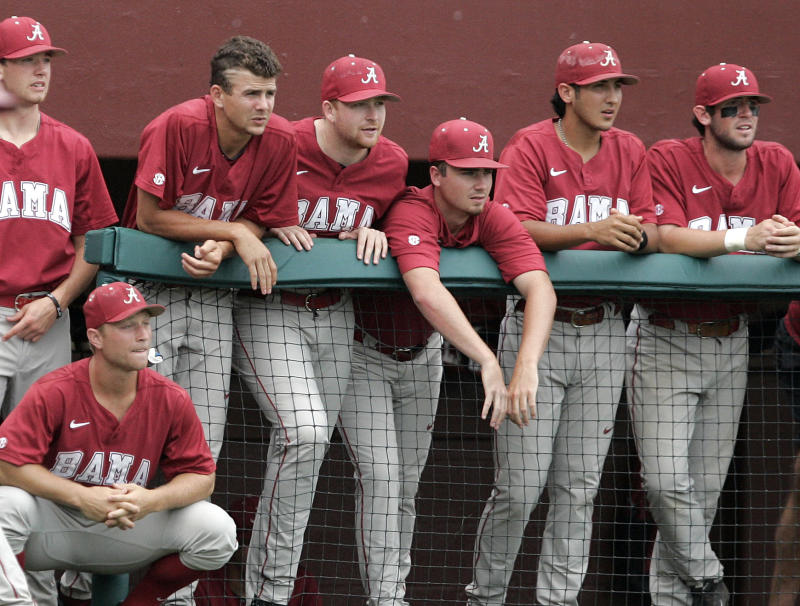 Players in the Alabama dugout watch their last out against Kennesaw State in an NCAA college baseball regional game on Monday, June 2, 2014, in Tallahassee, Fla. Kennesaw State won the rubber match over Alabama 4-2 to move on to the super regional expected to be in Louisville