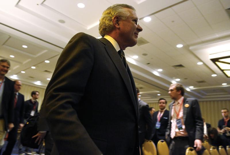 Federal Reserve Bank of Dallas President Fisher arrives to speak to a breakout group at the Conservative Political Action Conference in National Harbor, Maryland