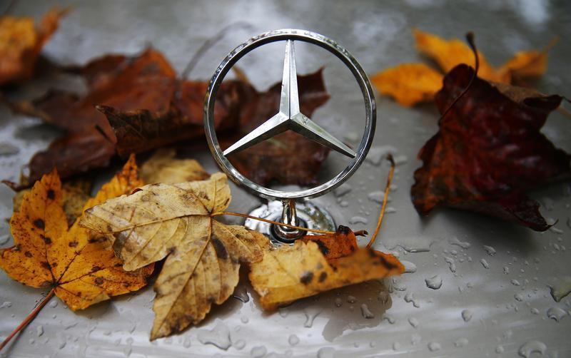 The emblem of German car manufacturer Mercedes-Benz, a subsidiary of Daimler AG, is pictured covered with raindrops at a parking lot in Hanau