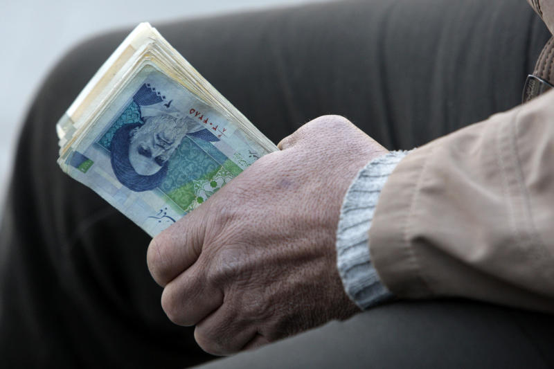 Iran tightens measures to stem currency fall