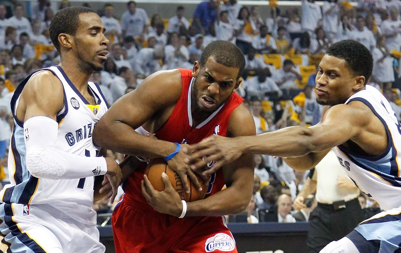 MEMPHIS, TN - MAY 13:  Chris Paul #3 of the Los Angeles Clippers drives between Mike Conley #11 and Rudy Gay #22 of the Memphis Grizzlies in Game Seven of the Western Conference Quarterfinals in the 2012 NBA Playoffs at FedExForum on May 13, 2012 in Memphis, Tennessee.  NOTE TO USER: User expressly acknowledges and agrees that, by downloading and or using this photograph, User is consenting to the terms and conditions of the Getty Images License Agreement  (Photo by Kevin C. Cox/Getty Images)