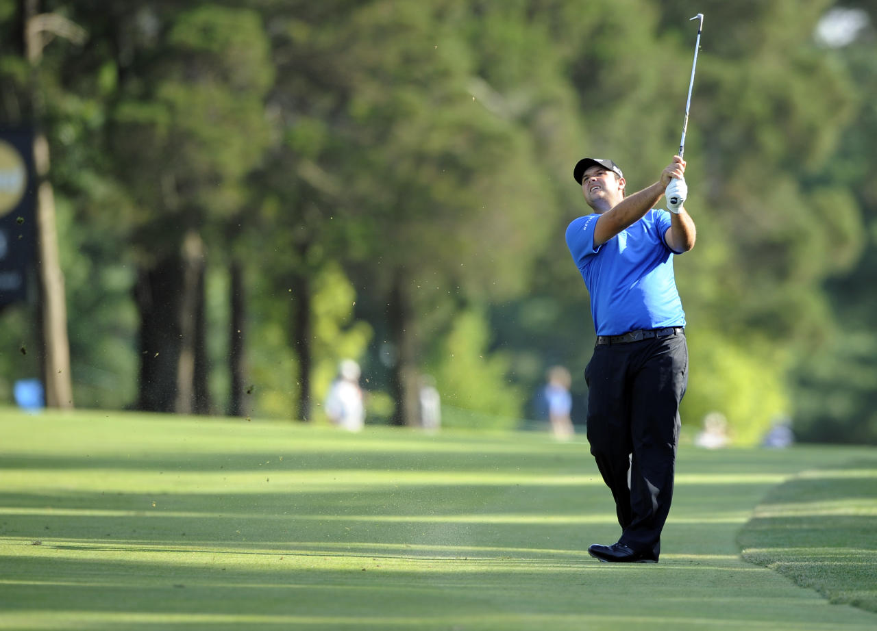 Patrick Reed watches his fairway shot on the 18th hole during the third round of the Quicken Loans National golf tournament, Saturday, June 28, 2014, in Bethesda, Md. (AP Photo/Nick Wass)