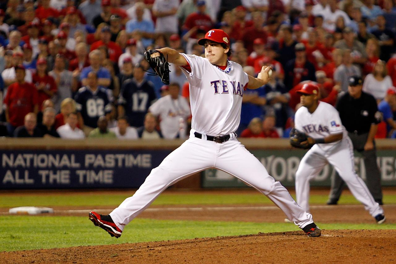 ARLINGTON, TX - OCTOBER 23: Derek Holland #45 of the Texas Rangers pitches in the ninth inning during Game Four of the MLB World Series against the St. Louis Cardinals at Rangers Ballpark in Arlington on October 23, 2011 in Arlington, Texas.  (Photo by Tom Pennington/Getty Images)