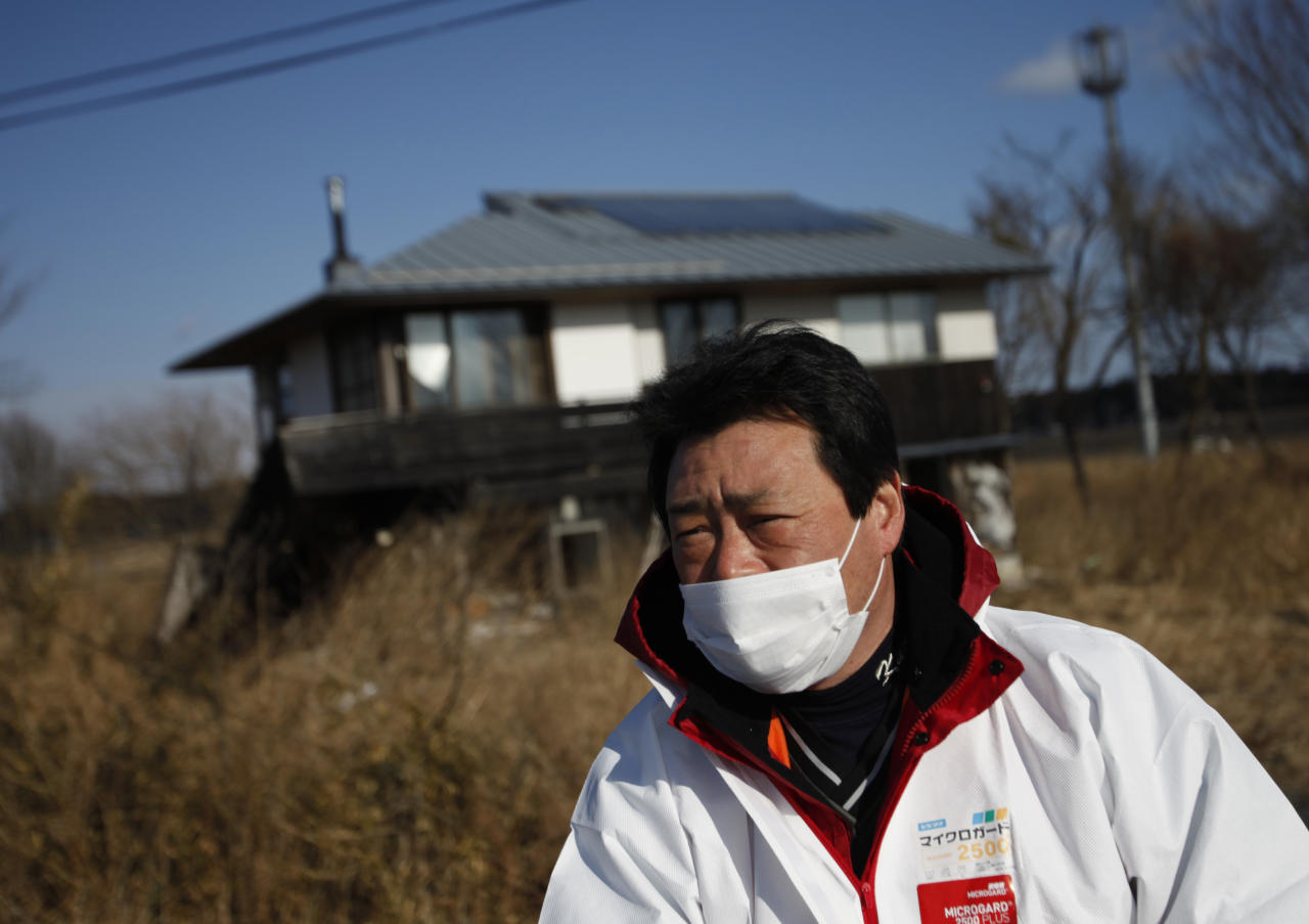 United Kennel Club Japan (UKC Japan) Representative Director Yasunori Hoso speaks in front of a destroyed house in Namie town, inside the 20km exclusion zone around the Fukushima Daiichi nuclear power plant, January 28, 2012.  Dogs and cats that were abandoned in the Fukushima exclusion zone after last year's nuclear crisis have had to survive high radiation and a lack of food, and they are now struggling with the region's freezing winter weather. A 9.0-magnitude earthquake and massive tsunami on March 11 triggered the world's worst nuclear accident in 25 years and forced residents around the Fukushima Daiichi nuclear power plant to flee, with many of them having to leave behind their pets. Picture taken January 28, 2012. REUTERS/Issei Kato
