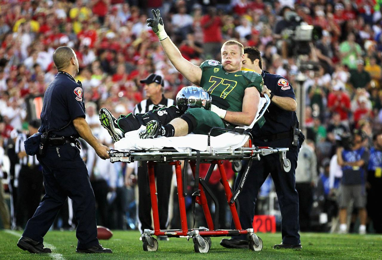 PASADENA, CA - JANUARY 02:  Offensive lineman Carson York #77 of the Oregon Ducks is carted off the field after an injury in the second half as the Ducks take on the Wisconsin Badgers at the 98th Rose Bowl Game on January 2, 2012 in Pasadena, California.  (Photo by Jeff Gross/Getty Images)