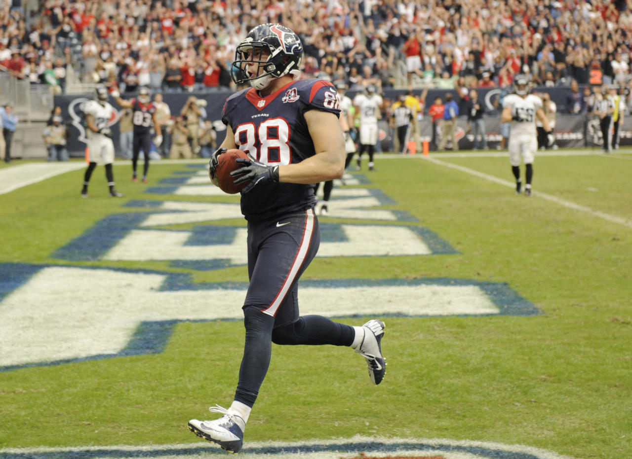 Houston Texans' Garrett Graham (88) scores a touchdown against the Jacksonville Jaguars during the fourth quarter of an NFL football game Sunday, Nov. 18, 2012, in Houston. The Texans won in overtime 43-37. (AP Photo/Dave Einsel)