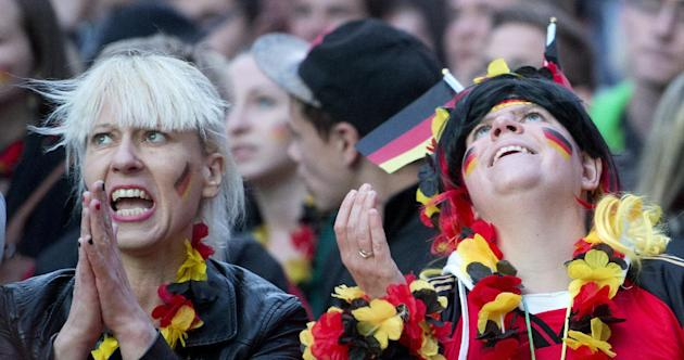 German soccer fans watch their team during the soccer World Cup 2014 match Germany vs Ghana at a public viewing zone in Chemnitz, central Germany, Saturday, June 21, 2014. (AP Photo/Jens Meyer)
