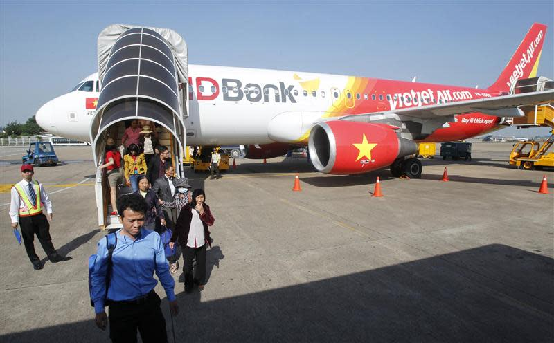 Vietjet Air passengers exit the aircraft after arriving at Tan Son Nhat airport in Vietnam's southern Ho Chi Minh city