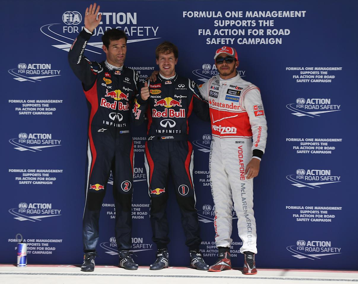 AUSTIN, TX - NOVEMBER 17:  Sebastian Vettel (C) of Germany and Red Bull Racing celebrates finishing first alongside second placed Lewis Hamilton (R) of Great Britain and McLaren and third placed Mark Webber (L) of Australia and Red Bull Racing following qualifying for the United States Formula One Grand Prix at the Circuit of the Americas on November 17, 2012 in Austin, Texas.  (Photo by Mark Thompson/Getty Images)