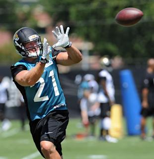 Toby Gerhart, practicing his PPR game. (AP Photo/The Florida Times-Union, Bob Mack)