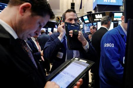 United States stocks mostly higher on stronger oil prices