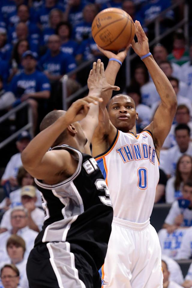 OKLAHOMA CITY, OK - JUNE 02:  Russell Westbrook #0 of the Oklahoma City Thunder shoots the ball over Boris Diaw #33 of the San Antonio Spurs in the first quarter in Game Four of the Western Conference Finals of the 2012 NBA Playoffs at Chesapeake Energy Arena on June 2, 2012 in Oklahoma City, Oklahoma. NOTE TO USER: User expressly acknowledges and agrees that, by downloading and or using this photograph, User is consenting to the terms and conditions of the Getty Images License Agreement.  (Photo by Brett Deering/Getty Images)