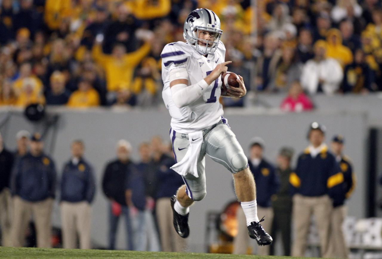 MORGANTOWN, WV - OCTOBER 20:  Collin Klein #7 of the Kansas State Wildcats carries the ball against the West Virginia Mountaineers during the game on October 20, 2012 at Mountaineer Field in Morgantown, West Virginia.  (Photo by Justin K. Aller/Getty Images)