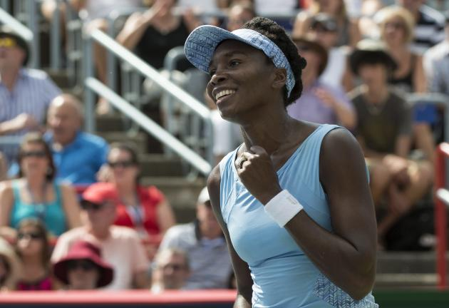 Venus Williams of the United States celebrates after beating her sister Serena 6-7, 6-2, 6-3 at the Rogers Cup Saturday. (AP Photo/The Canadian Press, Paul Chiasson)