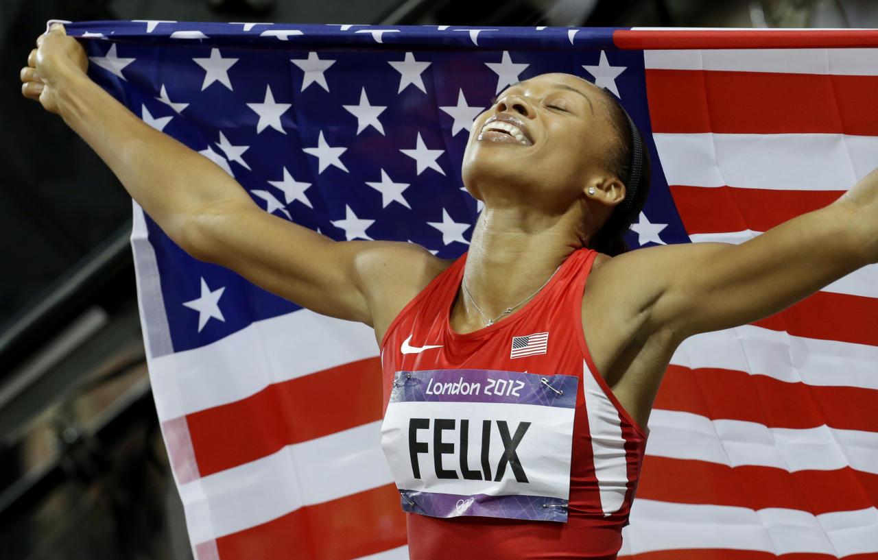 United States' Allyson Felix celebrates her in win the women's 200-meters during the athletics in the Olympic Stadium at the 2012 Summer Olympics, London, Wednesday, Aug. 8, 2012.