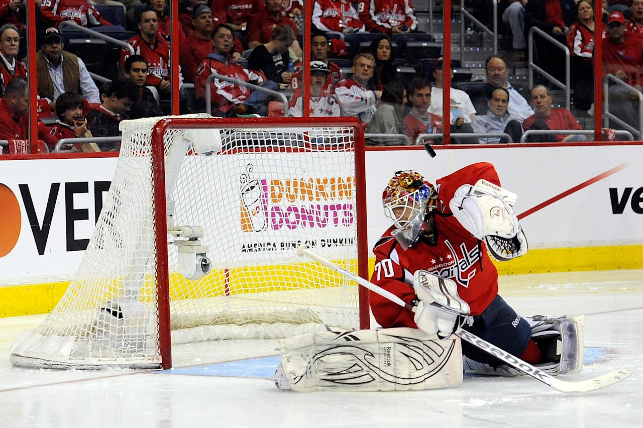WASHINGTON, DC - APRIL 16:  Rich Peverley #49 scores a goal against Braden Holtby #70 of the Washington Capitals during the second period of Game Three of the Eastern Conference Quarterfinals during the 2012 NHL Stanley Cup Playoffs at Verizon Center on April 16, 2012 in Washington, DC.  (Photo by Patrick McDermott/Getty Images)