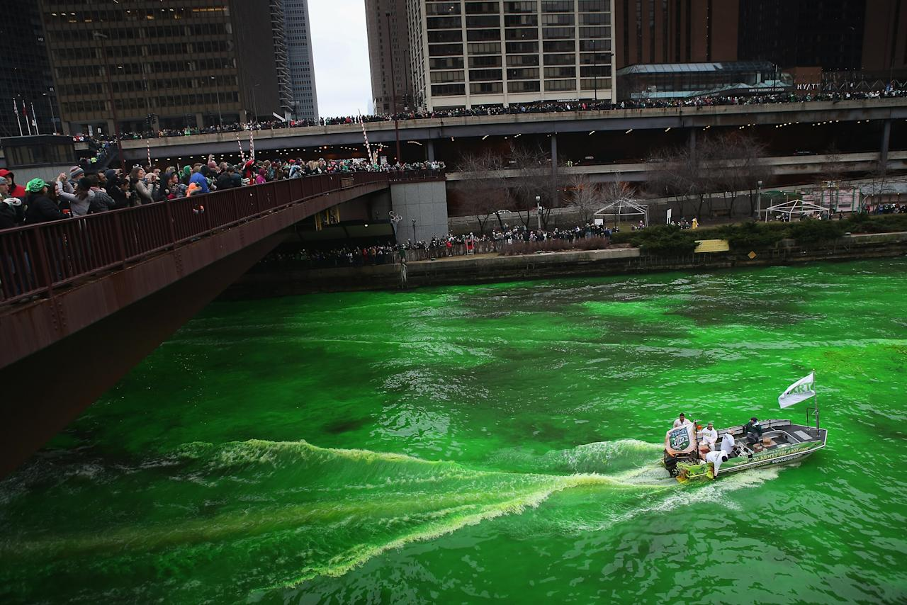 CHICAGO, IL - MARCH 16:  Workers dye the Chicago River green to kick off the city's St. Patrick's day celebration on March 16, 2013 in Chicago, Illinois. The dying of the river has been a tradition in the city for 43 years.  (Photo by Scott Olson/Getty Images)
