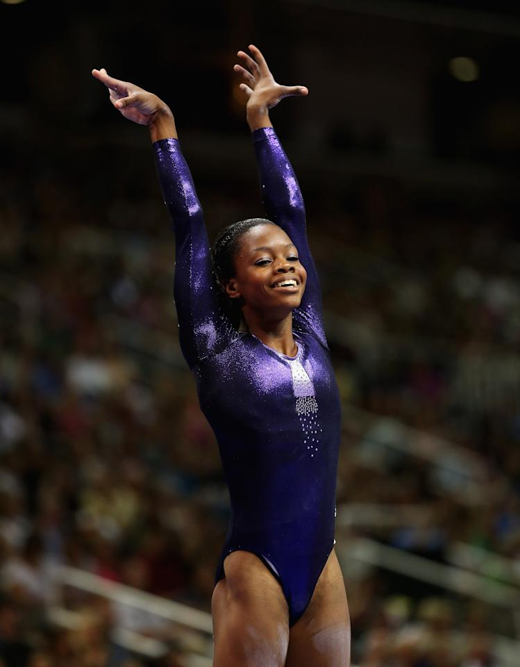 SAN JOSE, CA - JULY 01:  Gabrielle Douglas raises her hands after competing on the beam during day 4 of the 2012 U.S. Olympic Gymnastics Team Trials at HP Pavilion on July 1, 2012 in San Jose, California.  (Photo by Ezra Shaw/Getty Images)