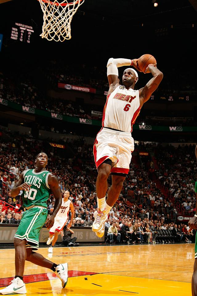 MIAMI, FL - OCTOBER 30: LeBron James #6 of the Miami Heat dunks against Brandon Bass #30 of the Boston Celtics during the NBA game on October 30, 2012 at American Airlines Arena in Miami, Florida. NOTE TO USER: User expressly acknowledges and agrees that, by downloading and/or using this photograph, user is consenting to the terms and conditions of the Getty Images License Agreement. Mandatory copyright notice: Copyright NBAE 2012 (Photo by Issac Baldizon/NBAE via Getty Images)