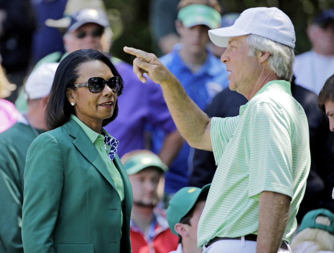 Former U.S. Secretary of State Condoleezza Rice speaks with Ben Crenshaw during the par three competition at the Masters golf tournament Wednesday, April 9, 2014, in Augusta, Ga. (AP Photo/David J. Phillip)
