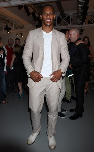 """<div class=""""caption-credit""""> Photo by: WireImage</div><div class=""""caption-title"""">International man of fashion</div>Cruz is also the only <i>Latino</i> included in 2012's Vanity Fair International Best Dressed List. Seen here at Milan's Menswear Fashion week, the football champ is showing a consistent awareness of fashion and mature sense of style."""