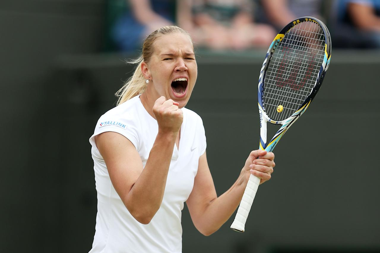 LONDON, ENGLAND - JULY 01: Kaia Kanepi of Estonia celebrates match point during her Ladies' Singles fourth round match against Laura Robson of Great Britain on day seven of the Wimbledon Lawn Tennis Championships at the All England Lawn Tennis and Croquet Club on July 1, 2013 in London, England. (Photo by Clive Brunskill/Getty Images)