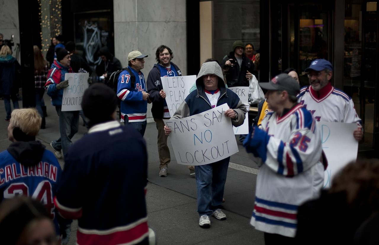 NEW YORK, NY - DECEMBER 1:  Hockey fans protest the National Hockey League (NHL) lockout outside the NHL offices in midtown Manhattan December 1, 2012 in New York City.  The NHL and the NHL Players' Association have been at a stalemate in brokering a new collective bargaining agreement leaving teams locked out for over 75 days.  (Photo by Allison Joyce/Getty Images)