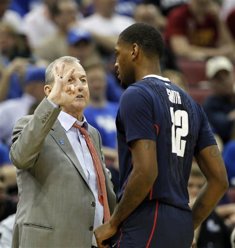 Connecticut head coach Jim Calhoun talks with forward Roscoe Smith (22) in the first half of their NCAA tournament second-round college basketball game in Louisville, Ky., Thursday, March 15, 2012. (AP Photo/John Bazemore)