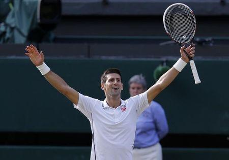 Novak Djokovic of Serbia celebrates defeating Roger Federer of Switzerland in their men's singles final tennis match at the Wimbledon Tennis Championships, in London