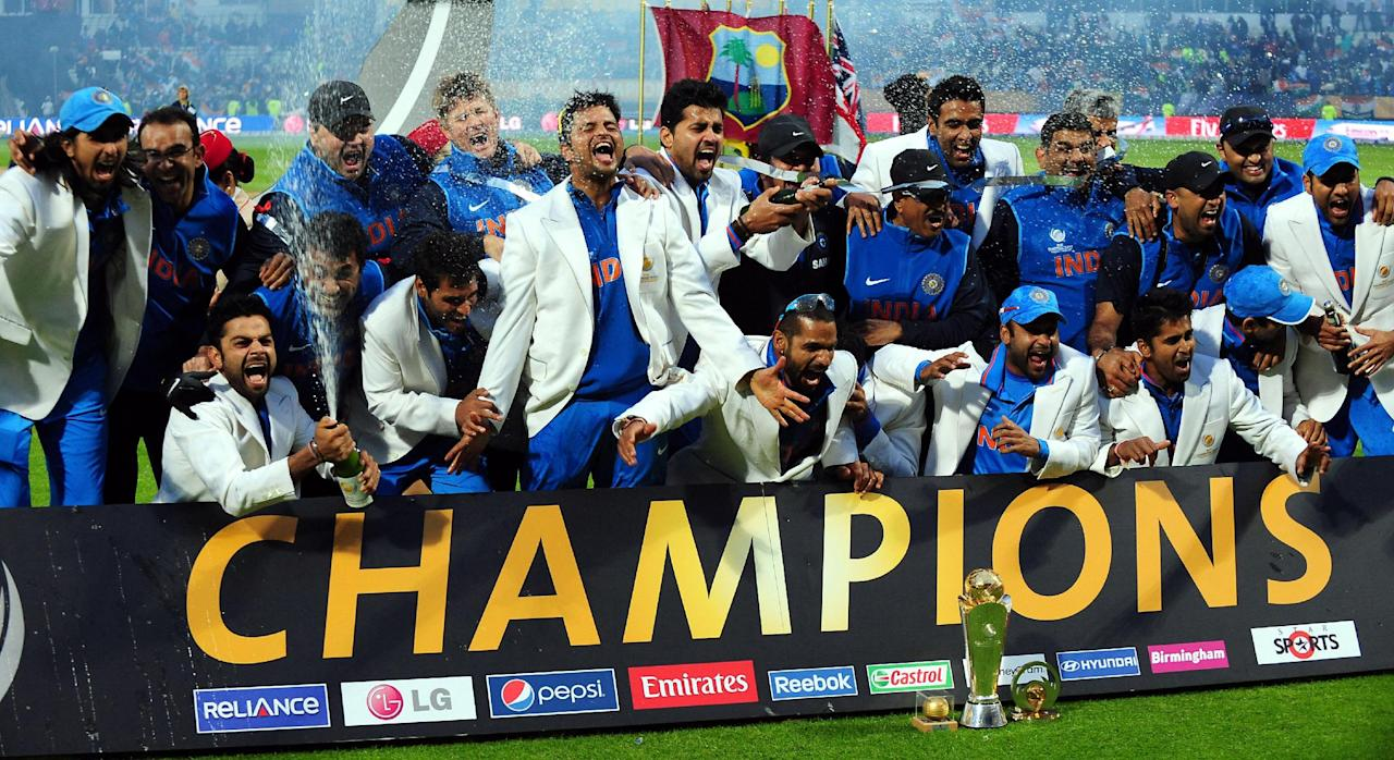 India celebrate with the trophy after beating England in the ICC Champions Trophy Final at Edgbaston, Birmingham.