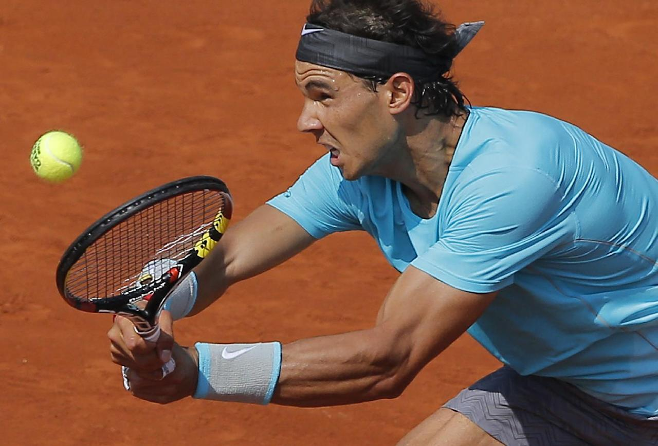 Spain's Rafael Nadal returns the ball to Argentina's Leonardo Mayer during their third round match of  the French Open tennis tournament at the Roland Garros stadium, in Paris, France, Saturday, May 31, 2014. (AP Photo/Michel Spingler)